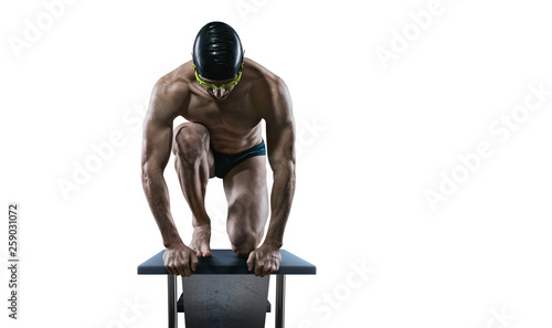 Swimming pool. Isolated muscular swimmer ready to jump. © vitaliy_melnik