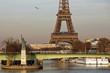 Paris, France - February 16, 2019: Liberty statue and Eiffel Tower near river seine in Paris