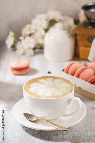 Cup of coffee and french macarons. Natural sunlight.