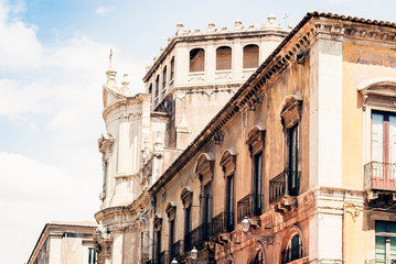 Beautiful cityscape of Italy, historical street of Catania, Sicily, facade of old buildings.