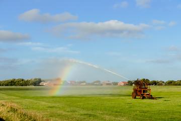 rainbow over field, in Sweden Scandinavia North Europe
