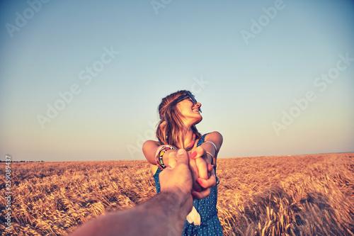Leinwandbild Motiv Young couple enjoying in a wheat field.