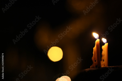candle in the dark © alongkorn