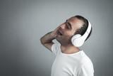Caucasian man with headphones. Listening music