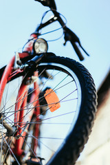 Close up of mountain bike tyres outside, summer day, city mobility. Bike in blurry background.