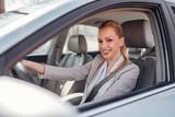 Portrait of elegant woman driving a car.