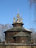 Wooden church in Kostroma, Russia on the spring blue sky background