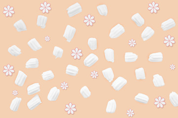 marshmallows for coffee and flowers on an orange background