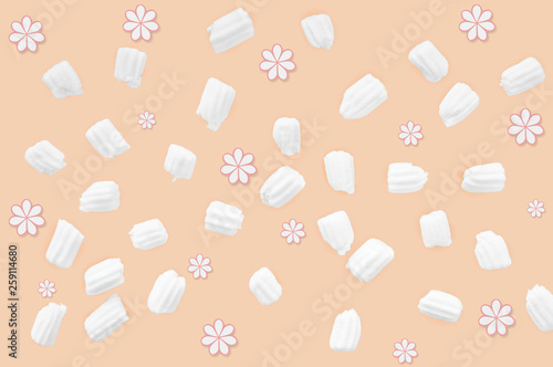 marshmallows for coffee and flowers on an orange background - 259114680