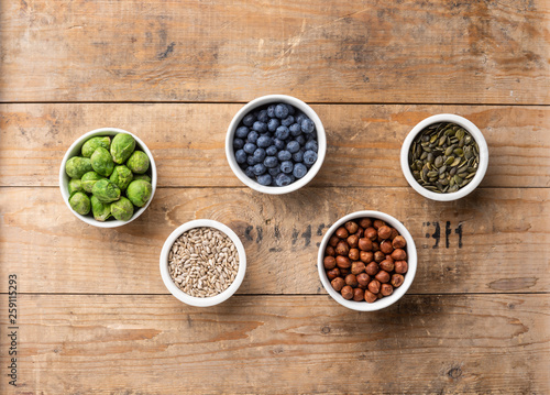 Healthy eating ingredients: fresh vegetables, fruits and superfood. Nutrition, diet, vegan food concept © Maksim Šmeljov