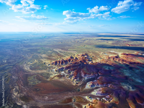 Bird-eye view on color mountains of Akzhar. Colored chalk formations in Akzhar mountains are located in Central Kazakhstan. © Yerbolat