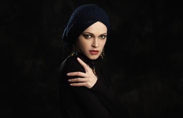 fashion studio portrait of a beautiful elegant woman wearing jewelry