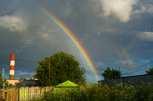 Rainbow in the sky. Weather after rain. All colors of the rainbow. Beautiful nature. Weather forecast. © Олег Копьёв
