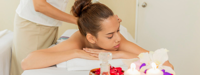 Thai massage on woman body in the spa salon. Relaxation and Beauty treatment concept. © Wisut