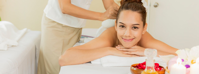 Thai massage on woman body in the spa salon. Relaxation and Beauty treatment concept.