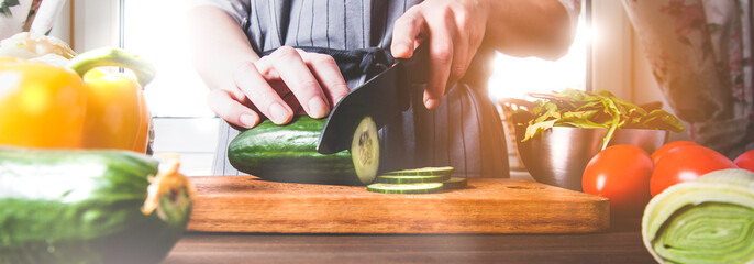 Cook cutting raw vegetables on a cutting Board © alekseyliss