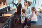 Family with kids looking at a kitchen in showroom