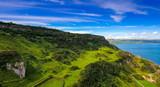 11907_The_big_greenish_mountain_fronting_the_big_sea_in_Cushendun.jpg
