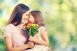 Quadro Portrait of happy mother and daughter holding  flowers