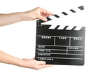 Female hands holding clapper board on white background