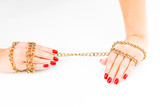 close up photo hands with red manicure holding chain on white