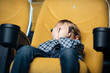 frightened boy holding hands on face while sitting in cinema and watching movie