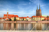 WROCLAW, POLAND - MARCH 30, 2019: Wroclaw Old Town. Cathedral Island (Ostrow Tumski) is the oldest part of the city. Odra River, boats and historic buildings in sunny day.