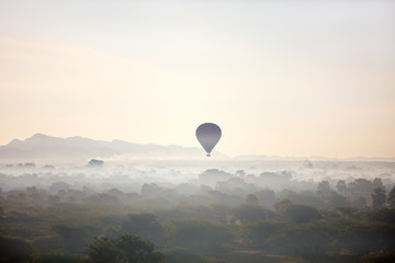 Hot air balloons fly over Bagan