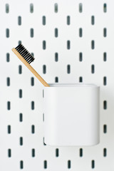 Bamboo toothbrush, plastic-free concept, zero waste, white background, side view © Vladimir