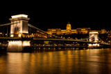 Night time view of the Buda Castle and the Szechenyi Chain Bridge over the Danube River in Budapest