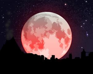 Eclipse lunar en la ciudad
