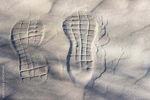 Shoe footprint on sand