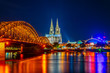 Leinwandbild Motiv Night view of the cathedral in Cologne and Hohenzollern bridge over Rhein, Germany