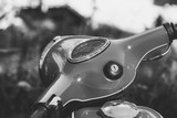 Black and white photo vintage scooter close up