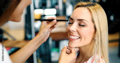 Makeup artist applies eye shadow. Perfect makeup - 259285423