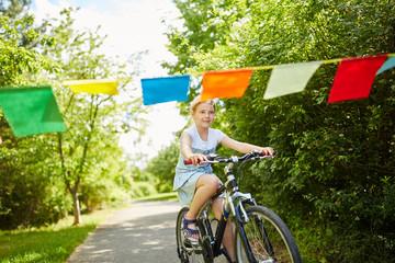 Girl making bike trip in the park