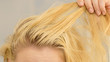 Blonde woman having greasy hair