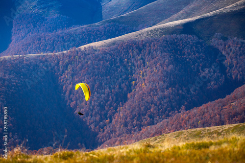 Paraglider flying over Carpathian mountains in summer autumn day. Borzhava. Ukraine. © Slavko Sereda