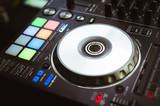 DJ plays and mix music on digital midi controller