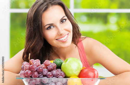 Woman with plate of fruits