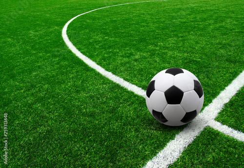 Leinwandbild Motiv Soccer ball on green football field