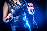 A woman is holding a whip. Sex games. Role-playing games. Domeniring. bdsm
