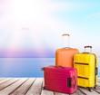 Leinwandbild Motiv Large suitcases on background,travel concept