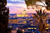 Rome rooftops and dome of the Papal Basilica of Saint Peter in Vatican evening view