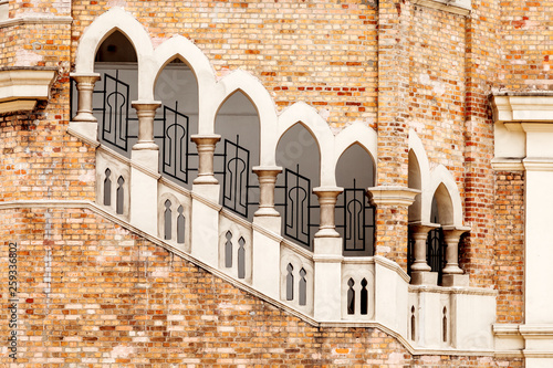 Lancet windows with staircase, architectural detail of old colonial style building Bangunan Sultan Abdul Samad, Sultan Abdul Samad Building. Kuala Lumpur, Malaysia.
