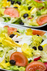 Detail of some dishes with salad