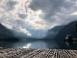 Fototapeta Fototapety na sufit - Zamazany widok jeziora i gór © C_.AE_photography_