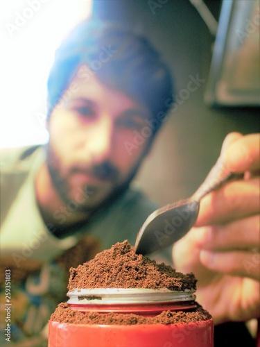 Man make a coffee with moka machine