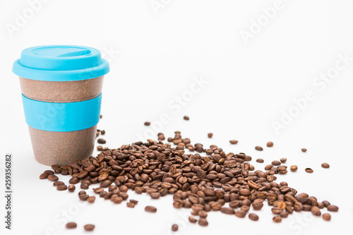 Coffee cup to Go with Coffee Beans on the white Background © lukasvetic