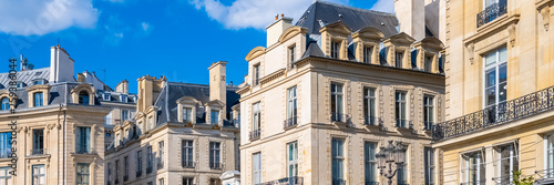 Paris, beautiful buildings place des Victoires, typical parisian facades and windows - 259386044